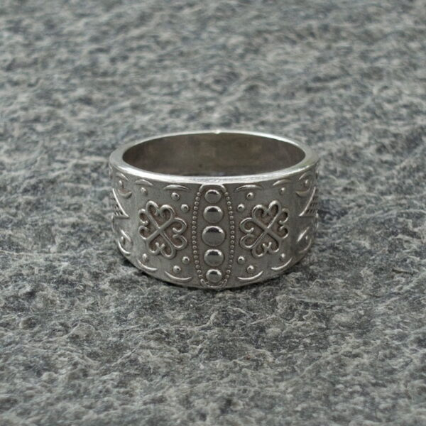silver ring from the same collection.